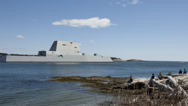 Spectators watch as the future USS Zumwalt heads out to sea from Bath, Maine. Navy photo