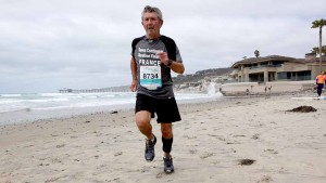 Michel Ribet, running on La Jolla beach after return from north pole. Photo by Christophe Fremont