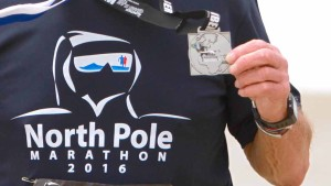Michel Ribet and his North Pole Marathon medal from April 16, 2016. Photo by Christophe Fremont