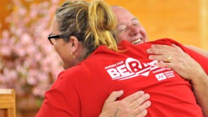 Erin McLeod, a nurse, and Jim Boydston congratulate each other after being selected as potential Sanders delegates. Photo by Chris Stone