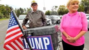 Trump supporters Sean Colgan and Fran Grady Hilhooly show their Trump sign in a Balboa Park parking lot. Photo by Chris Stone