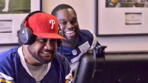 Defensive tackle Tenny Palepoi (left) and Chuka Ndulue react to the video game. Photo by Chris Stone