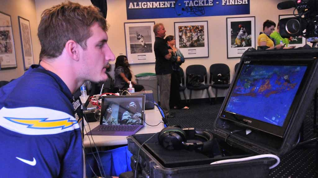 Chargers rookie Joey Bosa plays Call of Duty against fellow players and Marines. Photo by Chris Stone