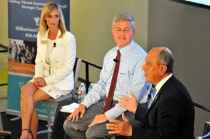 Encinitas Mayor Kristin Gaspar and Supervisor Dave Roberts listen to Escondido Mayor Sam Abed. Photo by Ken Stone