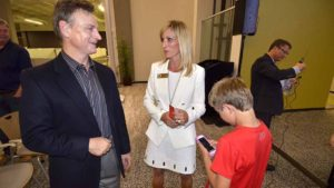 Steve Filsinger chats with Kristin Gaspar (with her son Carson) after debate, Photo by Ken Stone