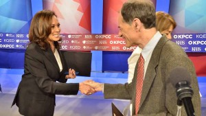 Democratic front-runner Kamala Harris shakes hands with late GOP entry Ron Unz after the debate. Photo by Ken Stone