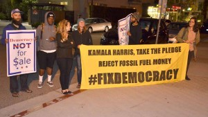 Greenpeace group awaits auto exit by Kamala Harris, hoping to speak with her. Photo by Ken Stone