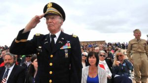 Retired Col. Marvin Muskat, 96, (left) and Andre Chappaz, 90, stand when the U.S. Army is honored. Photo by Chris Stone