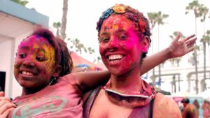 At the Oceanside Holi Festival of Color, participants danced and bathed themselves in spring colors. Photo by Chris Stone