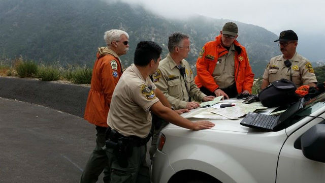 Los Angeles Sheriff's Deputies coordinating the search in the Angeles National Forest. Courtesy LASD