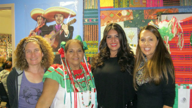 Sacha Boutros (second from right) at Mid-City Center.