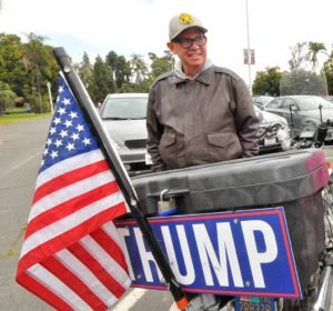 Sean Colgan displayed a Trump sign on his Honda motorcycle in a Balboa Park lot where Bill Clinton would see it. Photo by Chris Stone