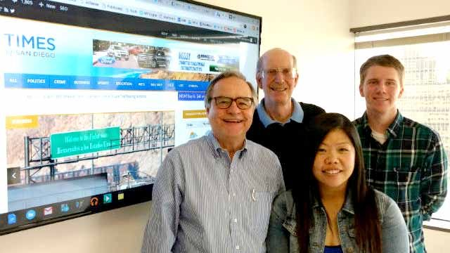 Times of San Diego staff members Chris Jennewein (left), Ken Stone, Hoa Quach and Zach Engberg in the website's shared office space at The Vine in downtown San Diego. Not shown are Debbie Sklar, Chris Stone and Cassia Pollock. Photo by Jerry Hall