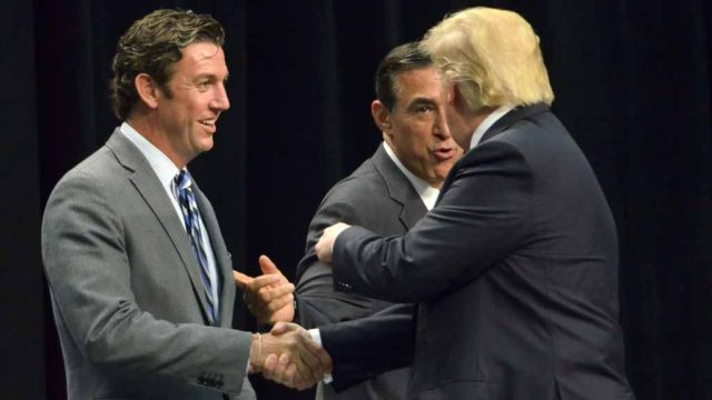 Donald Trump greets Rep. Duncan Hunter and Rep. Darrell Issa. Photo by Chris Stone