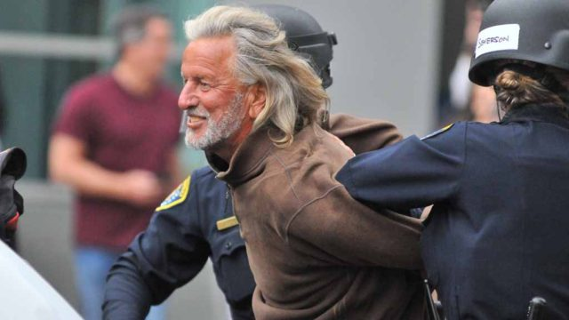 A man was arrested toward the end of the demonstrations in downtown San Diego. Photo by Chris Stone