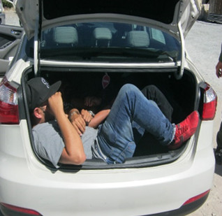Three people were found hidden in a car trunk trying to cross the border. Photo courtesy of U.S. Border Patrol