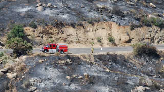 A lone fire truck amid the devastation of the Border Fire. Courtesy County News Center