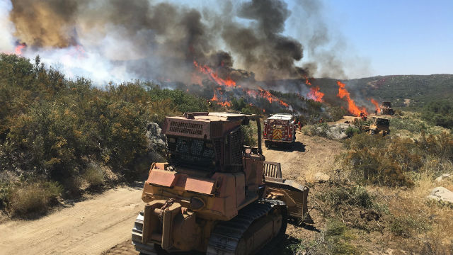 Firefighters on the line Friday afternoon at the Border Fire. Photo courtesy CalFire