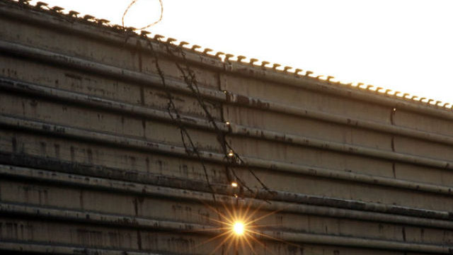 Border fence at sunset