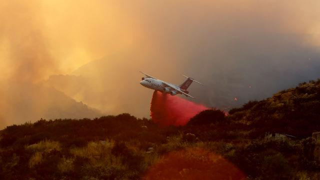A tanker drops fire retardant on the Border fire. Photo by Kevin Pack / Cal Fire
