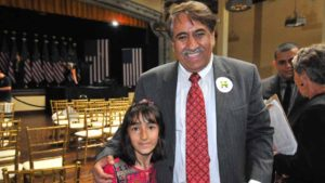Proud father Tajuddin Millatmal of Spring Valley with 7-year-old daughter Hatsanda after Hillary Clinton talk. Photo by Chris Stone
