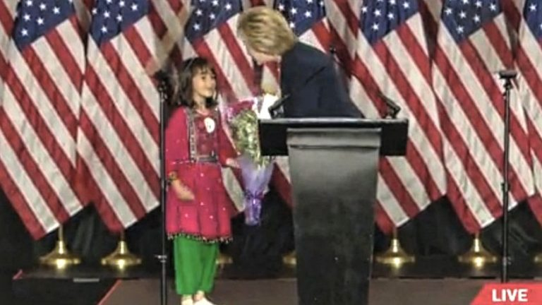 Hillary Clinton accepts flowers from Hatsanda Millatmal, 7, of Spring Valley. Photo via Twitter