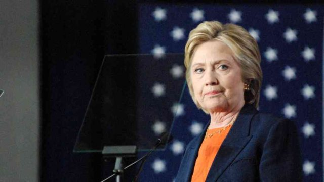 Hillary Clinton pauses during foreign policy talk in San Diego. Photo by Ken Stone