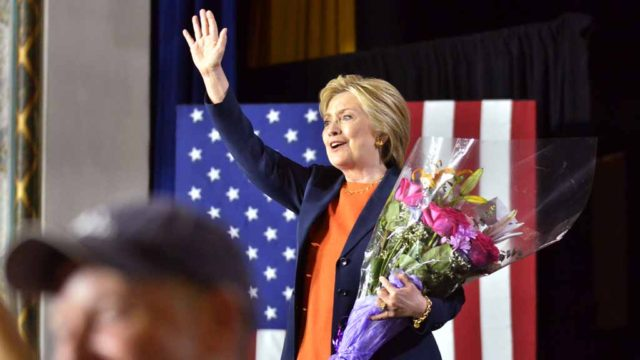 Hillary Clinton was given flowers by a 7-year-old girl. Photo by Chris Stone