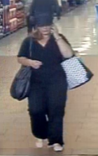 A woman suspected of stealing credit cards leaves a store. Courtesy of San Diego County Crime Stoppers