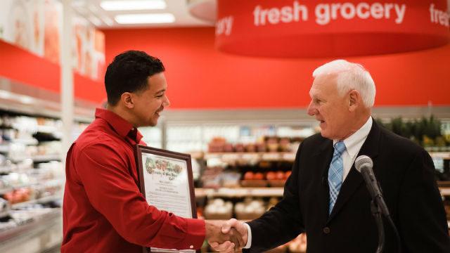 Supervisor Ron Roberts (right) congratulates Target Store Team Leader Matthew Johnson.  Courtesy Target