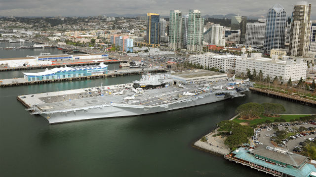 The USS Midway with downtown San Diego in the background. Courtesy Port of San Diego