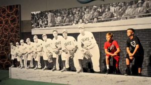 Two boys pose at a dugout display in the Negro Leagues section. Photo by Chris Stone