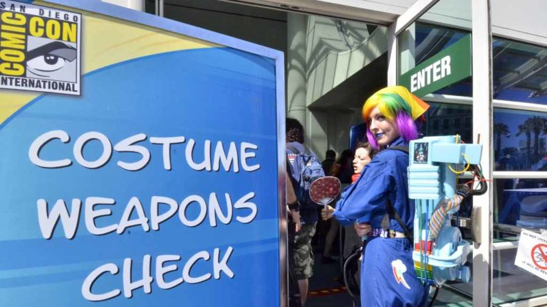 """Emma Roberts of Scottsdale checks in her """"weapon"""" at security at Comic-Con. Photo by Chris Stone"""