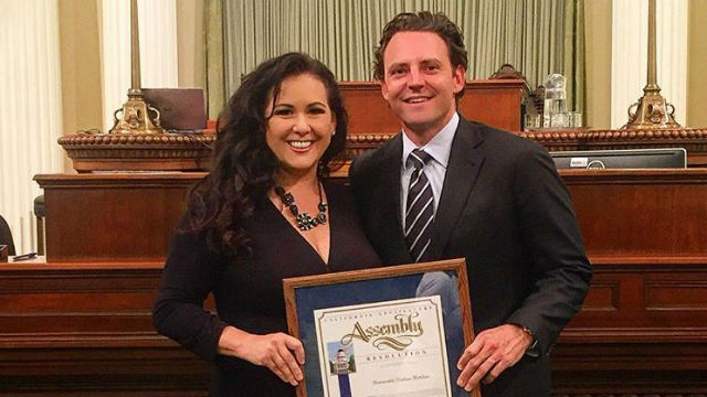 "Assemblywoman Lorena Gonzalez and Nathan Fletcher holding the ""Veteran of the Year"" award. Photo from Nathan_Fletcher/Instagram"