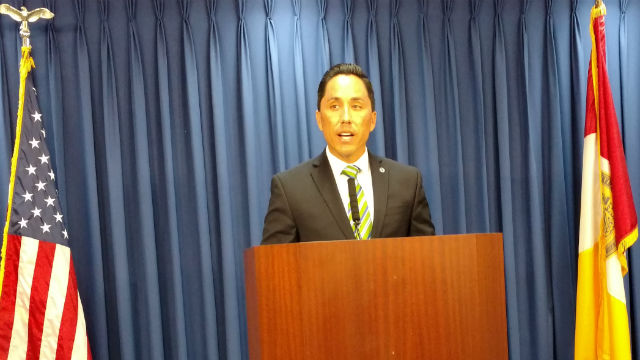 Todd Gloria announces the new minimum wage Monday at a press conference at City Hall. Photo by Chris Jennewein