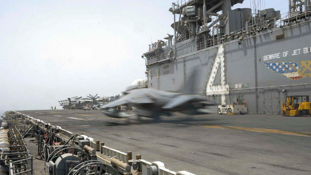 A Marine Corps AV8-B Harrier launches from the San Diego-based USS Boxer in the Arabian Sea. Marine Corps photo