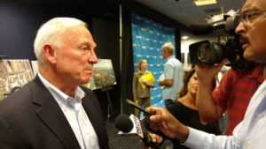 Jerry Sanders is interviewed after the press conference.