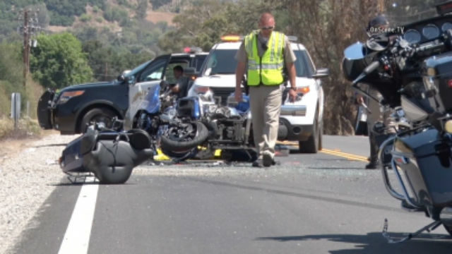 A law enforcement official surveys the motorcycle wreckage. Courtesy OnScene.TV