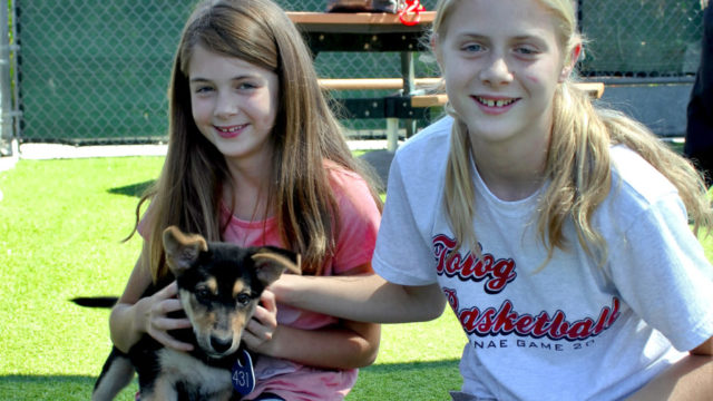 Millie, the puppy, with her new family. Courtesy of San Diego County