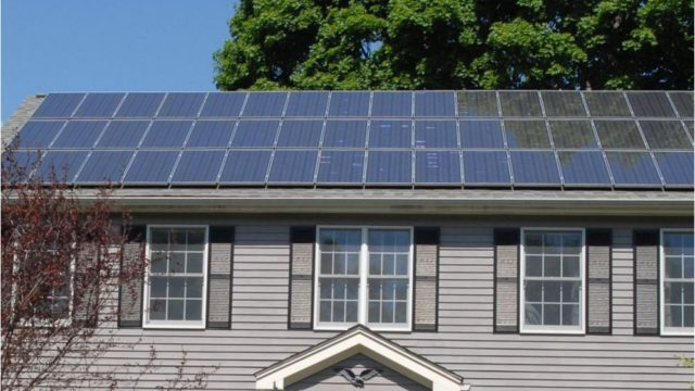 Solar panels on a traditional residence. Courtesy Solar to the People