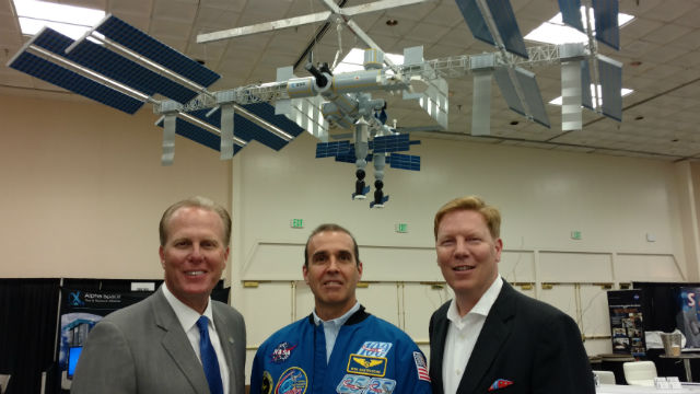 Mayor Kevin Faulconer (left), Astronaut Rick Mastracchio and Greg McKee of CONNECT under a model of the International Space Station. Photo by Chris Jennewein