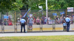 Philadelphia police monitor fence and Bernie Sanders supporters outside the convention. Photo by Chris Stone