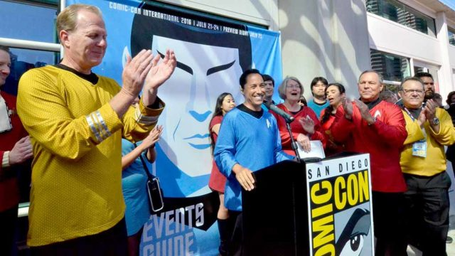 Mayor Kevin Faulconer applauds as Councilman Todd Gloria (in blue) addresses Comic-Con news conference. Photo by Chris Stone