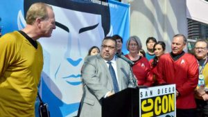 Comic-Con International Director of Marketing and Public Relations David Glanzer speaks while Mayor Faulconer and City Council President Sherri Lightner look on. Photo by Chris Stone