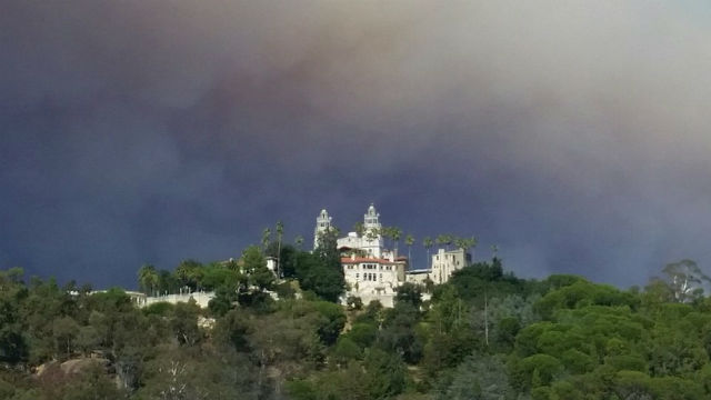 Smoke from the Chimney Fire billows above historic Hearst Castle on Monday. Courtesy California State Parks