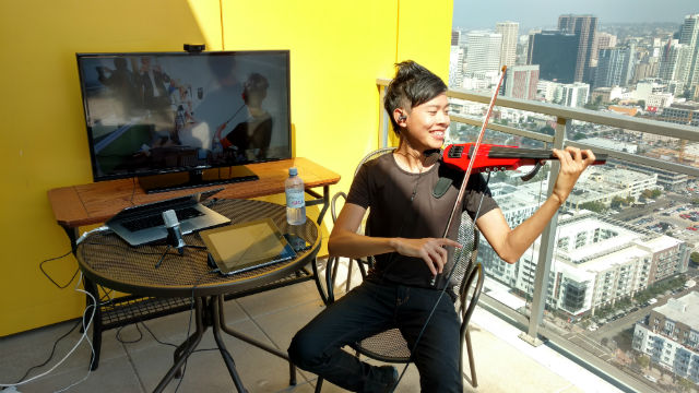 Jason Yang leads a multi-state violin lesson over a high-speed video connection. Photo by Chris Jennewein