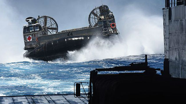 A landing craft air cushion approaches the well deck of the USS San Diego off the Hawaiian Islands. Navy photo