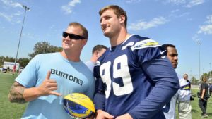 Joey Bosa poses with a fan in his first NFL Boot Camp at Miramar Marine Air Station. Photo by Chris Stone
