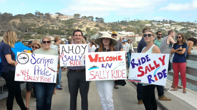 Scripps personnel with signs welcoming the R/V Sally Ride. Photo by Chris Jennewein