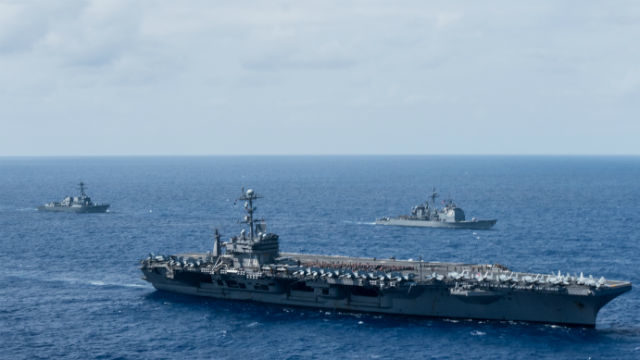 The USS Lawrence (left) and USS Mobile By accompany the nuclear-powered aircraft carrier USS John C. Stennis. Navy photo